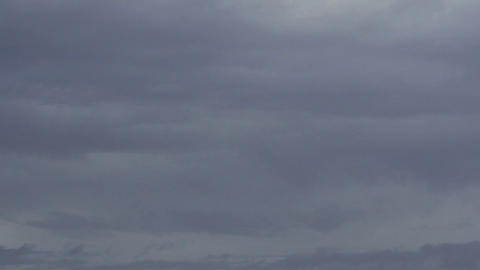 A time lapse of dark clouds Stock Video Footage