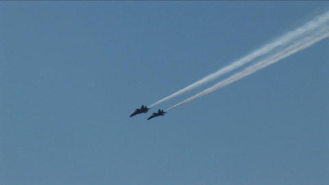 Four Blue Angels jets fly in formation Live Action