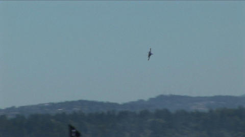 A Blue Angels jet makes a sharp turn in the air Footage
