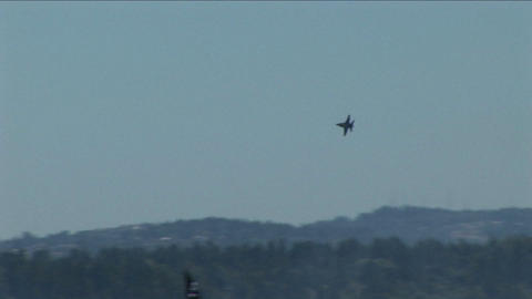 A Blue Angels jet makes a sharp turn in the air Stock Video Footage