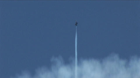 A Blue Angels jet barrel rolls straight into the sky Stock Video Footage