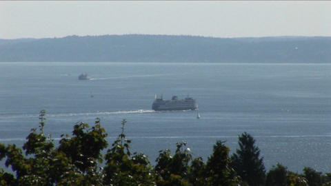 Ferries move slowly across a lake Stock Video Footage