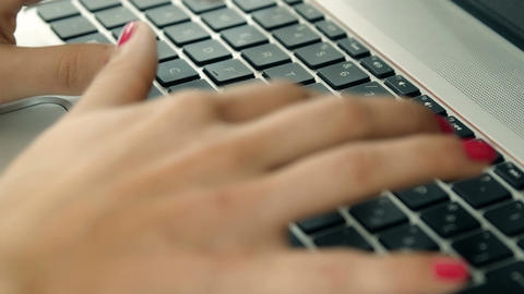 closeup footage on hands of woman typing on the keyboard of a laptop Footage