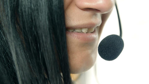 Close-up of smiling woman working in a call center. Customer service Footage