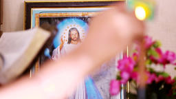 Focuses Shift Jesus Photos to Candle, A hand with a matchstick lighting a candle Footage