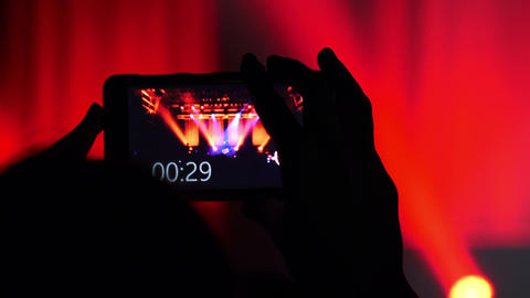 audience of a concert: people taking video with smartphone Live Action