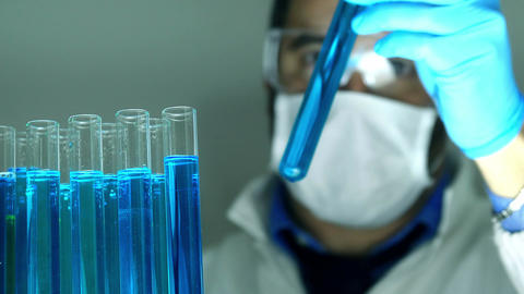 scientist working in a laboratory with test tubes and pipette Footage