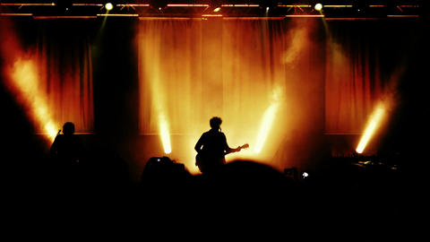 rock concert: silhouette of guitarist playing on the stage Footage