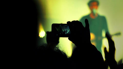 audience at the concert: rock music, smartphone, photos, video Live Action
