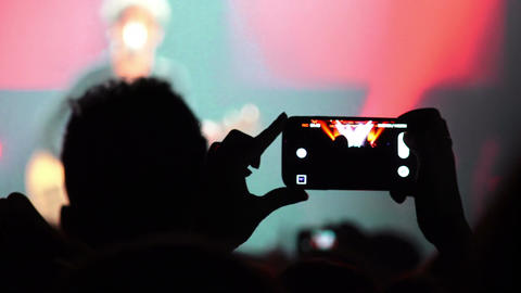audience of a concert: people taking video with smartphone Footage