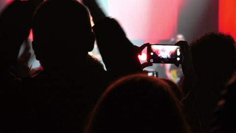 audience of a concert: people using a camera to take video or photo Footage