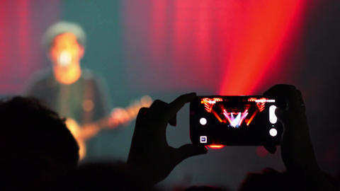 making photo or video in a rock concert Live Action