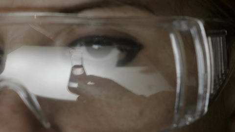 young woman, chemist, laboratory, specialized equipment Live Action