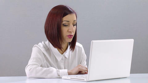 young secretary has problems using a laptop computer:…, Live Action