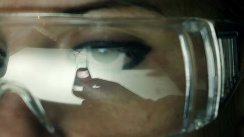 portrait of a researcher working in a laboratory with safety glasses Footage