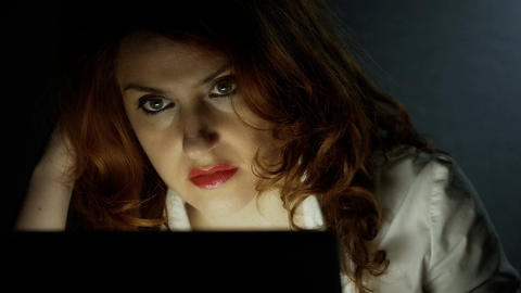 business woman working in the night with her laptop, white shirt, red lipstick Footage