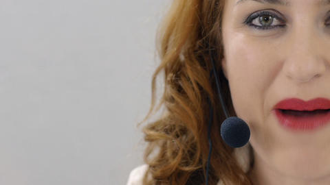 portrait of delicate call center opetator, eyes opened, talking Footage
