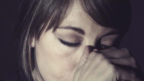 depressed woman praying and crying in the dark Footage