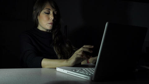 smiling woman using the computer in the night: having a flirt Footage