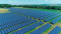 Aerial View. Flying Over The Solar Power Plant With Sun. Solar Panels And Sun Live Action