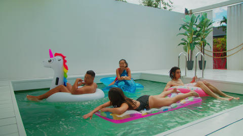 Group of friends together in swimming pool leisure Live Action