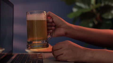 Drinking Beer with Friends via the Internet at Home. Person Celebrating by Cold Alcohol Drinks and Live Action