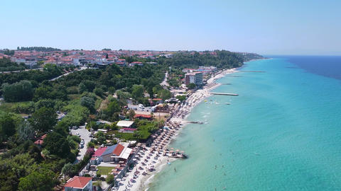 Aerial view of vacation resort with sand beach, beach bars and luxury hotels and crystal clear Live Action