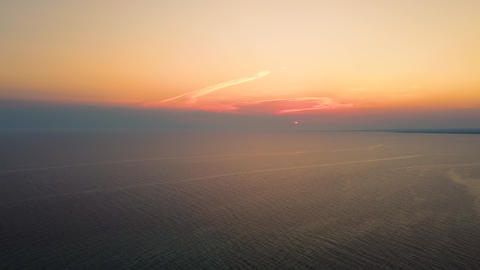 Aerial view of the sunset on the sea. Amazing colors of the sky and sunset on the sea in summer time Live Action