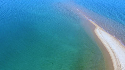 Exotic tropic transparent turquoise sea and exotic sandbank beach. Aerial view. Slow wind moving Live Action