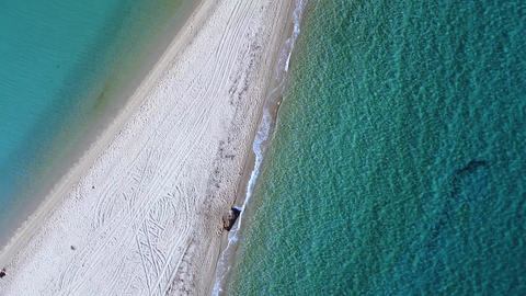 Tropic sandbank beach and turquoise crystal clear sea. Aerial view Live Action