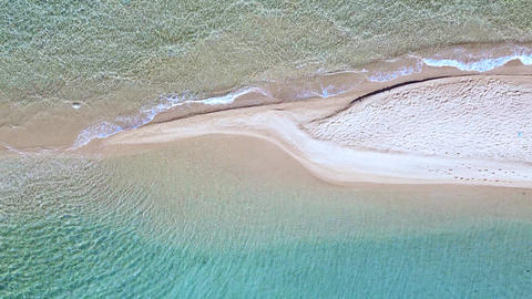 Top view of exotic sandbank beach and turquoise clear sea splashing beach. Aerial view Live Action