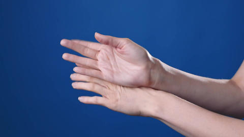 Close up shot of the womans hands are applying hands cream 2 Live Action