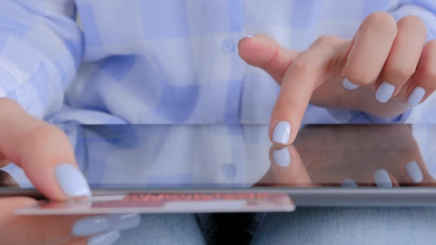 Online shopping - woman using tablet device and credit card - close up view Live Action