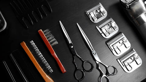 Stylish equipment table with scissors and trimmers and dark scull at the barber shop 4 Live Action