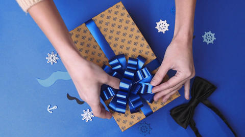 Wrapping the present parcel decoration box with presents Live Action