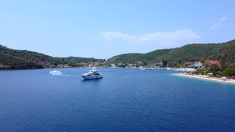 Expensive yacht in blue tranquil bay on summer vacation. Aerial view Live Action