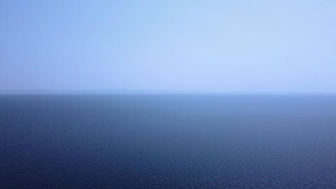 Aerial view of tranquil blue open sea under the blue sky Live Action