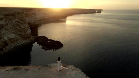 arch shape grotto in ocean in ocean island, bride after wedding in honeymoon Live Action