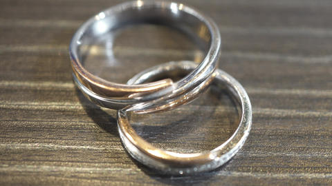 Macro photography, paired rings on the table, wedding rings Live Action