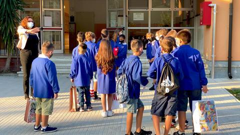 PISA, ITALY - SEPTEMBER 14, 2020: Elementary school classmates return to school Live Action