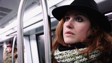 traveling on a subway train: elegant young woman pensive: lost in her thougths Footage