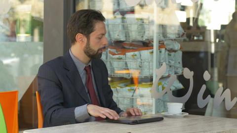 businessman sitting in a cafè finish its work and drinking coffee Footage
