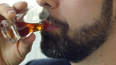 closeup footage of young businessman drinking alcohol Live Action