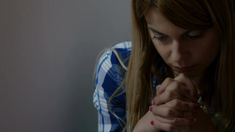 religious and sad woman in prayer: problems, faith, christianity, god, religion Footage