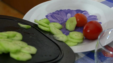 putting vegetables in the dish after cutting over the chopping board Footage