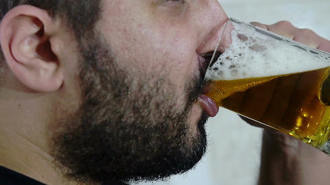 side view of young man drinking beer Live Action