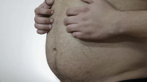 overweight problems: man hits his belly with his hands Footage