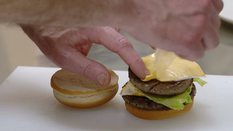 making an hamburger sandwich in a fast food kitchen Footage