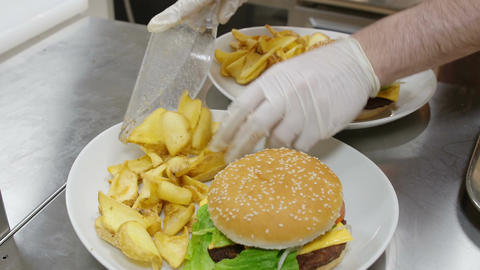 plate of hamburger with fries: fast food restaurant Footage