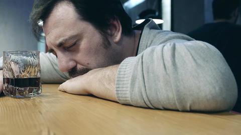 depressed drunk man sleeping on the bar Footage